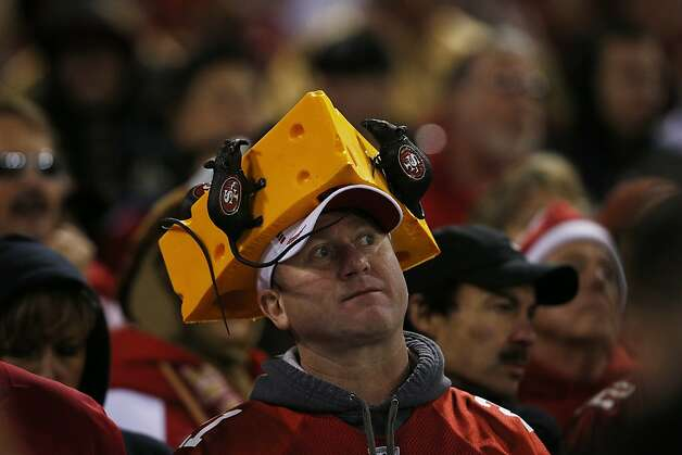 A 49ers football fan watches the game during the second quarter of a NFL football game between the San Francisco 49ers and Green Bay Packers at Candlestick Park in San Francisco, Calif. on Saturday, January 12, 2013. Photo: Stephen Lam, Special To The Chronicle