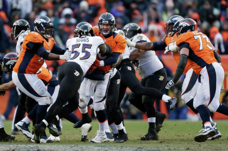 Denver Broncos quarterback Peyton Manning (18) is hit by Baltimore Ravens outside linebacker Terrell Suggs (55) after throwing in the third quarter of an AFC divisional playoff NFL football game, Saturday, Jan. 12, 2013, in Denver. (AP Photo/Joe Mahoney) Photo: Joe Mahoney, Associated Press / FR170458 AP