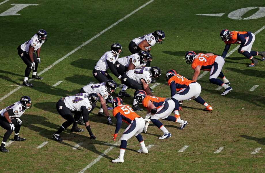 Baltimore Ravens quarterback Joe Flacco (5) calls an audible against the Denver Broncos in the first quarter of an AFC divisional playoff NFL football game, Saturday, Jan. 12, 2013, in Denver. (AP Photo/Julie Jacobson) Photo: Julie Jacobson, Associated Press / AP