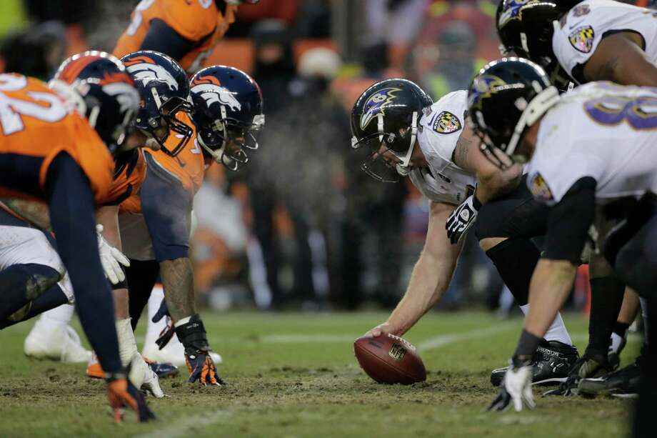 The Denver Broncos and Baltimore Ravens prepare for the snap in the third quarter of an AFC divisional playoff NFL football game, Saturday, Jan. 12, 2013, in Denver. (AP Photo/Charlie Riedel) Photo: Charlie Riedel, Associated Press / AP