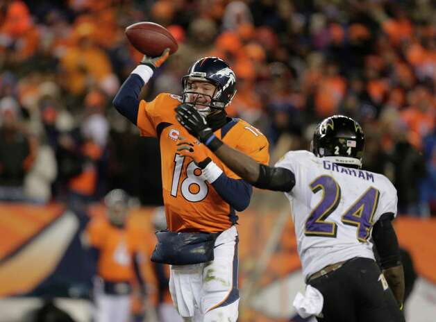 Denver Broncos quarterback Peyton Manning (18) throws under pressure from Baltimore Ravens cornerback Corey Graham (24) in the fourth quarter of an AFC divisional playoff NFL football game, Saturday, Jan. 12, 2013, in Denver. (AP Photo/Charlie Riedel) Photo: Charlie Riedel, Associated Press / AP