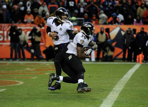 Baltimore Ravens quarterback Joe Flacco (5) hands the ball off in the end zone to Baltimore Ravens running back Bernard Pierce (30) in the third quarter of an AFC divisional playoff NFL football game, Saturday, Jan. 12, 2013, in Denver. (AP Photo/Jack Dempsey) Photo: Jack Dempsey, Associated Press / FR42408 AP
