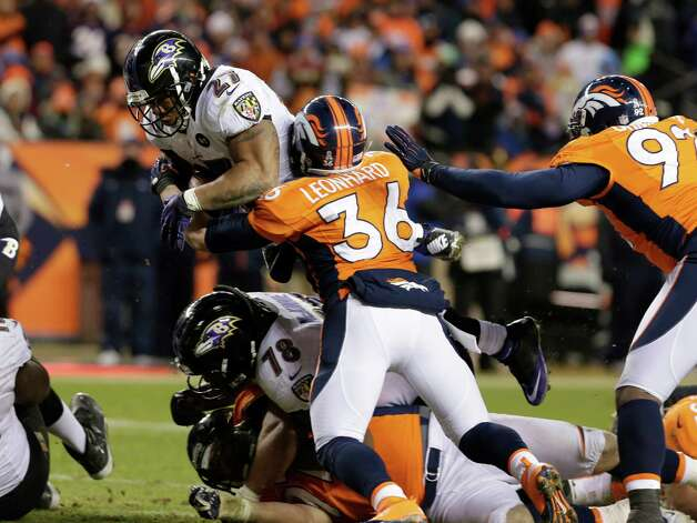 Baltimore Ravens defensive back Emanuel Cook (26) leaps for a first down against Denver Broncos free safety Jim Leonhard (36) in the third quarter of an AFC divisional playoff NFL football game, Saturday, Jan. 12, 2013, in Denver. (AP Photo/Joe Mahoney) Photo: Joe Mahoney, Associated Press / FR170458 AP