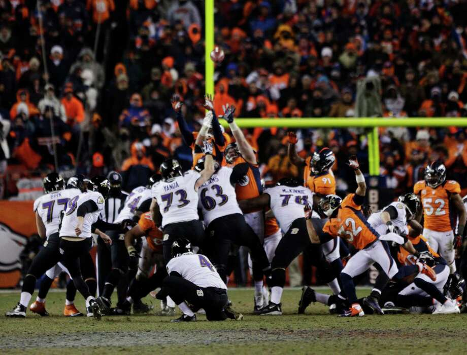 Baltimore Ravens kicker Justin Tucker (9) kicks the game-winning field goal against the Denver Broncos in overtime of an AFC divisional playoff NFL football game, Saturday, Jan. 12, 2013, in Denver. The Ravens won 38-35.  (AP Photo/Joe Mahoney) Photo: Joe Mahoney, Associated Press / FR170458 AP