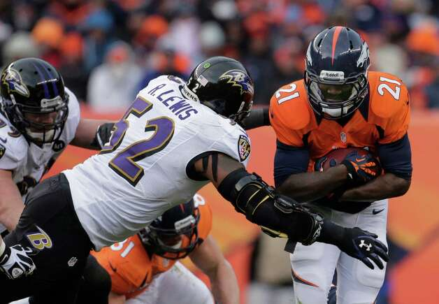 Denver Broncos running back Ronnie Hillman, right, is tackled by Baltimore Ravens inside linebacker Ray Lewis (52) in the second quarter of an AFC divisional playoff NFL football game, Saturday, Jan. 12, 2013, in Denver. (AP Photo/Charlie Riedel) Photo: Charlie Riedel, Associated Press / AP