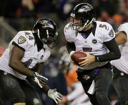 Baltimore Ravens quarterback Joe Flacco (5) looks to hand off the ball against the Denver Broncos in the fourth quarter of an AFC divisional playoff NFL football game, Saturday, Jan. 12, 2013, in Denver. (AP Photo/Charlie Riedel) Photo: Charlie Riedel, Associated Press / AP