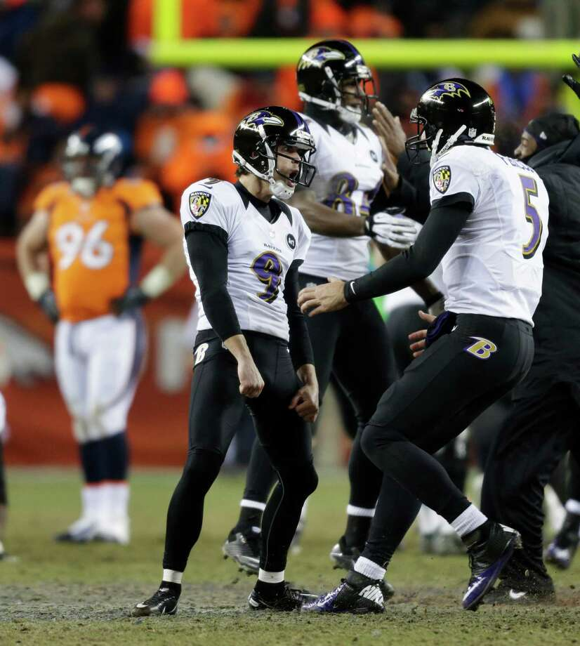 Baltimore Ravens kicker Justin Tucker (9) and quarterback Joe Flacco (5) celebrate after Tucker hit the game-winning field goal against the Denver Broncos in overtime of an AFC divisional playoff NFL football game, Saturday, Jan. 12, 2013, in Denver. The Ravens won 38-35. (AP Photo/Joe Mahoney) Photo: Joe Mahoney, Associated Press / FR170458 AP