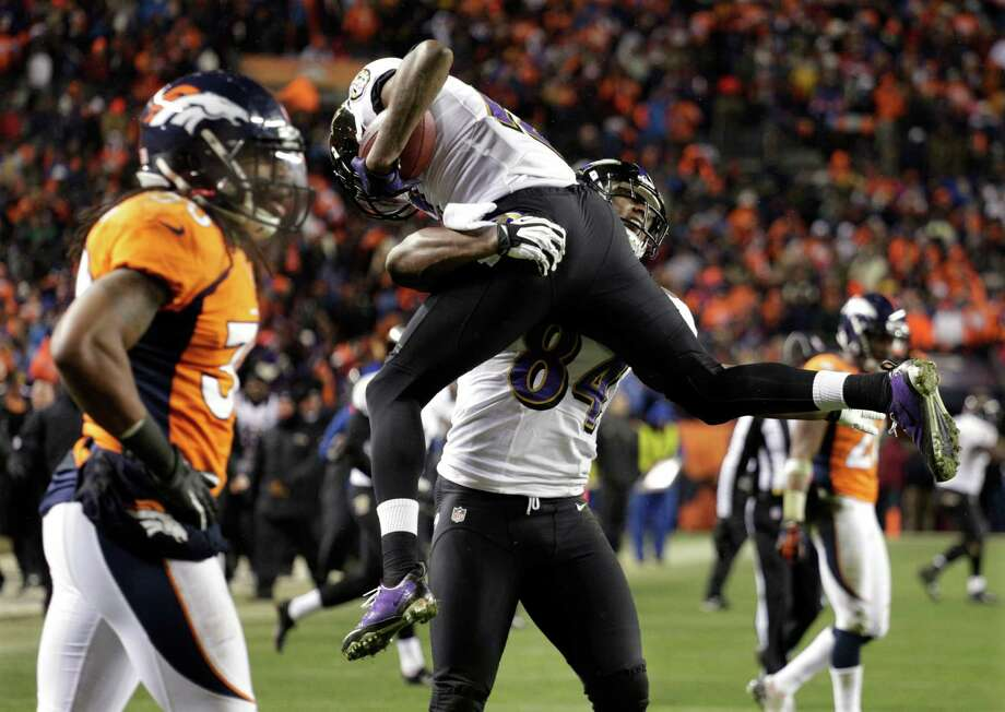 Baltimore Ravens tight end Ed Dickson (84) lifts Baltimore Ravens wide receiver Jacoby Jones after Jones scored a touchdown against the Denver Broncos late in the fourth quarter of an AFC divisional playoff NFL football game, Saturday, Jan. 12, 2013, in Denver. (AP Photo/Joe Mahoney) Photo: Joe Mahoney, Associated Press / FR170458 AP