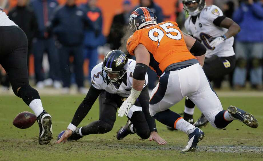 Baltimore Ravens quarterback Joe Flacco (5) fumbles the ball as Denver Broncos defensive end Derek Wolfe looks for the loose ball in the third quarter of an AFC divisional playoff NFL football game, Saturday, Jan. 12, 2013, in Denver. (AP Photo/Charlie Riedel) Photo: Charlie Riedel, Associated Press / AP