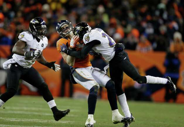 Denver Broncos tight end Joel Dreessen (81) is hit by Baltimore Ravens defensive back Chykie Brown (23) as Baltimore Ravens inside linebacker Dannell Ellerbe (59) looks on in the fourth quarter of an AFC divisional playoff NFL football game, Saturday, Jan. 12, 2013, in Denver. (AP Photo/Joe Mahoney) Photo: Joe Mahoney, Associated Press / FR170458 AP