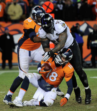 Denver Broncos quarterback Peyton Manning (18) is sacked by Baltimore Ravens outside linebacker Terrell Suggs (55) as Denver Broncos tackle Ryan Clady blocks in the fourth quarter of an AFC divisional playoff NFL football game, Saturday, Jan. 12, 2013, in Denver. (AP Photo/Jack Dempsey) Photo: Jack Dempsey, Associated Press / FR42408 AP