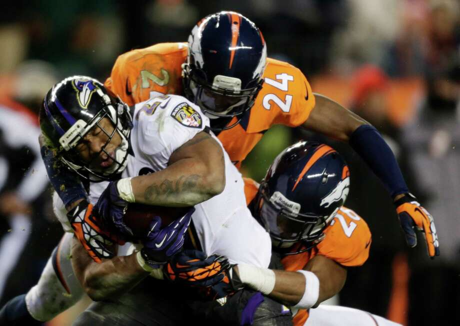 Denver Broncos cornerback Champ Bailey (24) and Denver Broncos free safety Rahim Moore bring down Baltimore Ravens running back Ray Rice n the third quarter of an AFC divisional playoff NFL football game, Saturday, Jan. 12, 2013, in Denver. (AP Photo/Joe Mahoney) Photo: Joe Mahoney, Associated Press / FR170458 AP