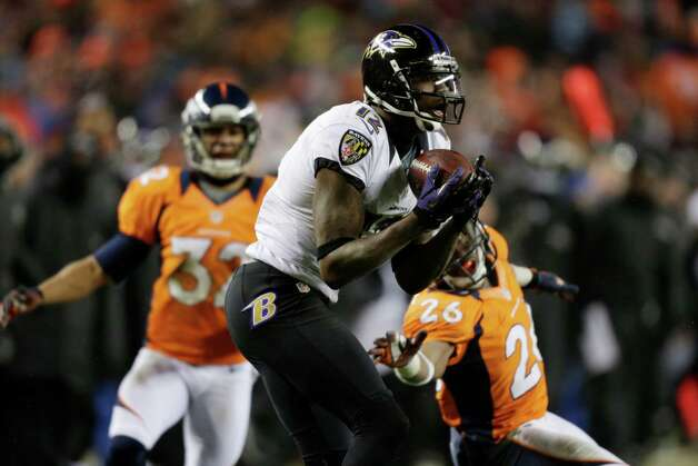 Baltimore Ravens wide receiver Jacoby Jones (12) catches a touchdown pass as Denver Broncos free safety Rahim Moore (26) and Denver Broncos defensive back Tony Carter (32) defend in the fourth quarter of an AFC divisional playoff NFL football game, Saturday, Jan. 12, 2013, in Denver. (AP Photo/Joe Mahoney) Photo: Joe Mahoney, Associated Press / FR170458 AP