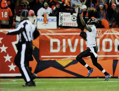 Baltimore Ravens wide receiver Jacoby Jones (12) reacts after catching a touchdown pass against the Denver Broncos late in the fourth quarter of an AFC divisional playoff NFL football game, Saturday, Jan. 12, 2013, in Denver. (AP Photo/Jack Dempsey) Photo: Jack Dempsey, Associated Press / FR42408 AP