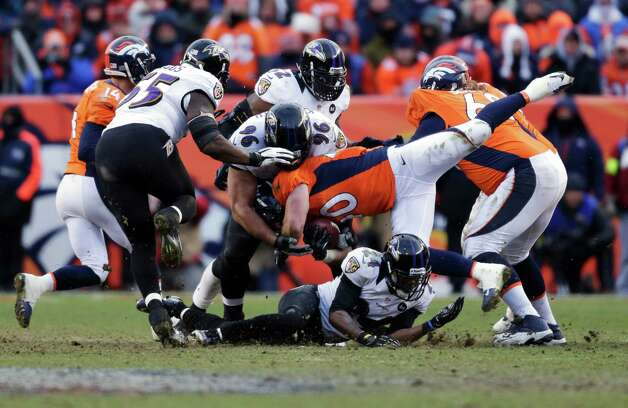 Denver Broncos running back Jacob Hester (40) is tackled by Baltimore Ravens nose tackle Ma'ake Kemoeatu (96) in the third quarter of an AFC divisional playoff NFL football game, Saturday, Jan. 12, 2013, in Denver. (AP Photo/Joe Mahoney) Photo: Joe Mahoney, Associated Press / FR170458 AP