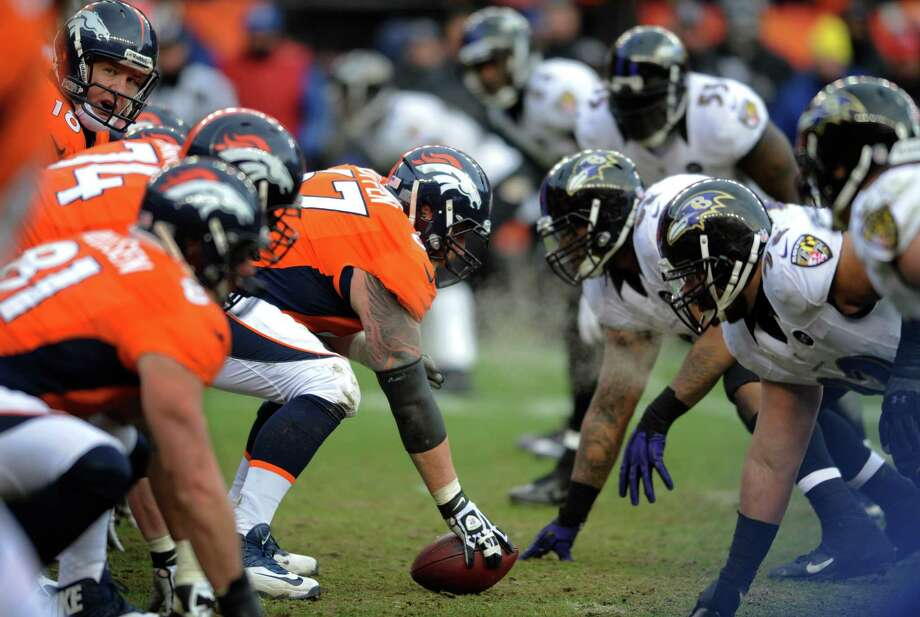 Denver Broncos center Dan Koppen (67) prepares to snap the ball against the Baltimore Ravens in the second quarter of an AFC divisional playoff NFL football game, Saturday, Jan. 12, 2013, in Denver. (AP Photo/Jack Dempsey) Photo: Jack Dempsey, Associated Press / FR42408 AP