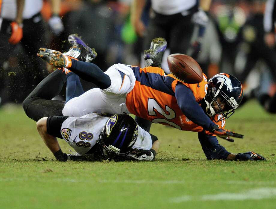 Denver Broncos strong safety Mike Adams (20) breaks up a pass intended for Baltimore Ravens tight end Dennis Pitta (88) in the fourth quarter of an AFC divisional playoff NFL football game, Saturday, Jan. 12, 2013, in Denver. (AP Photo/Jack Dempsey) Photo: Jack Dempsey, Associated Press / FR42408 AP