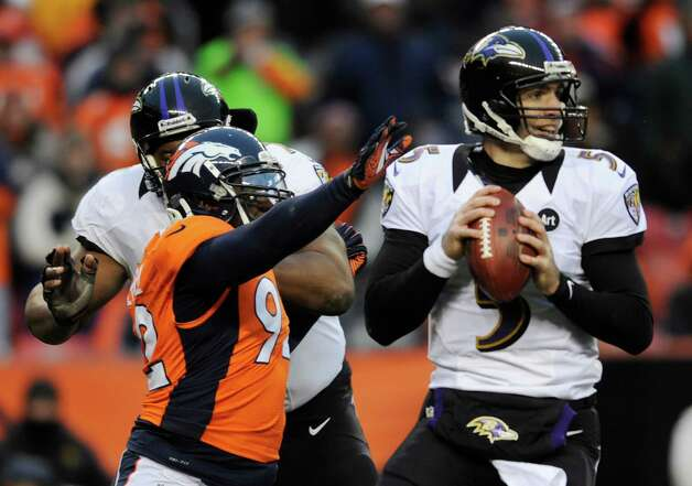Baltimore Ravens quarterback Joe Flacco (5) steps back to pass against the Denver Broncos in the third quarter of an AFC divisional playoff NFL football game, Saturday, Jan. 12, 2013, in Denver. (AP Photo/Jack Dempsey) Photo: Jack Dempsey, Associated Press / FR42408 AP