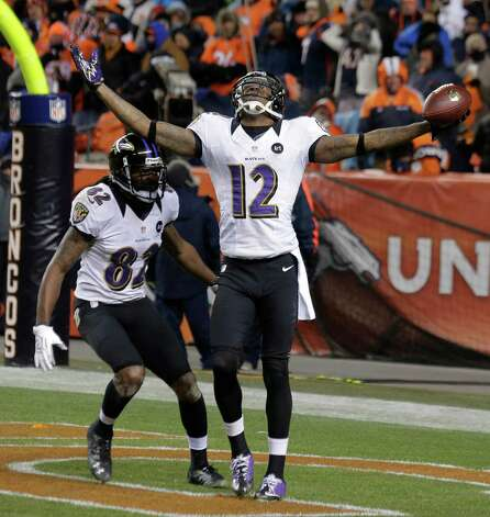 Baltimore Ravens wide receiver Jacoby Jones celebrates with Baltimore Ravens wide receiver Torrey Smith (82) after scoring a touchdown against the Denver Broncos to tie the score late in the fourth quarter of an AFC divisional playoff NFL football game, Saturday, Jan. 12, 2013, in Denver. (AP Photo/Charlie Riedel) Photo: Charlie Riedel, Associated Press / AP