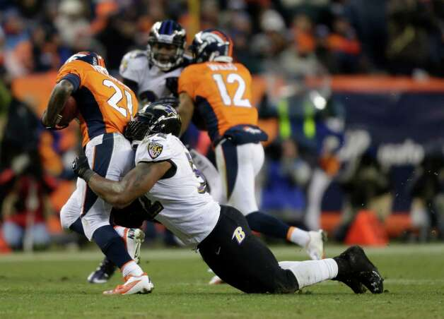 Baltimore Ravens inside linebacker Ray Lewis (52) tackles Denver Broncos running back Ronnie Hillman (21) in the third quarter of an AFC divisional playoff NFL football game, Saturday, Jan. 12, 2013, in Denver. (AP Photo/Joe Mahoney) Photo: Joe Mahoney, Associated Press / FR170458 AP