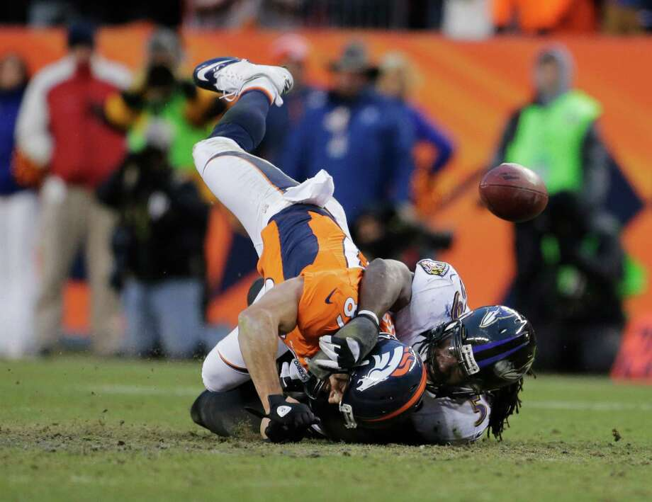 Baltimore Ravens inside linebacker Dannell Ellerbe (59) breaks up a pass intended for Denver Broncos wide receiver Eric Decker (87) in the third quarter of an AFC divisional playoff NFL football game, Saturday, Jan. 12, 2013, in Denver. (AP Photo/Charlie Riedel) Photo: Charlie Riedel, Associated Press / AP
