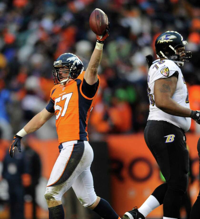 Denver Broncos middle linebacker Keith Brooking holds up the ball after recovering a fumble by the Baltimore Ravens in the third quarter of an AFC divisional playoff NFL football game, Saturday, Jan. 12, 2013, in Denver. (AP Photo/Jack Dempsey) Photo: Jack Dempsey, Associated Press / FR42408 AP
