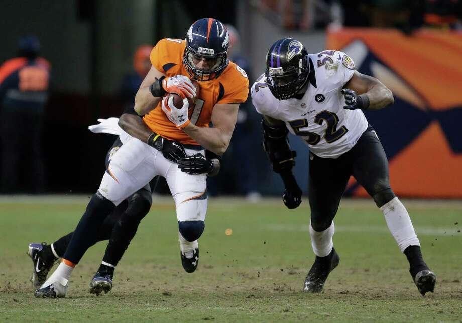 Denver Broncos tight end Joel Dreessen is tackled by Baltimore Ravens inside linebacker Ray Lewis (52) in the third quarter of an AFC divisional playoff NFL football game, Saturday, Jan. 12, 2013, in Denver. (AP Photo/Charlie Riedel) Photo: Charlie Riedel, Associated Press / AP