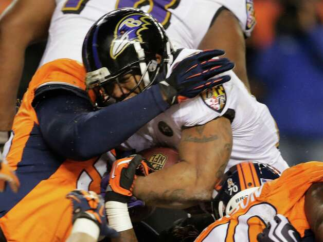 Baltimore Ravens running back Ray Rice (27) pushes his way across the goal line for a touchdown against the Denver Broncos in the third quarter of an AFC divisional playoff NFL football game, Saturday, Jan. 12, 2013, in Denver. (AP Photo/Charlie Riedel) Photo: Charlie Riedel, Associated Press / AP