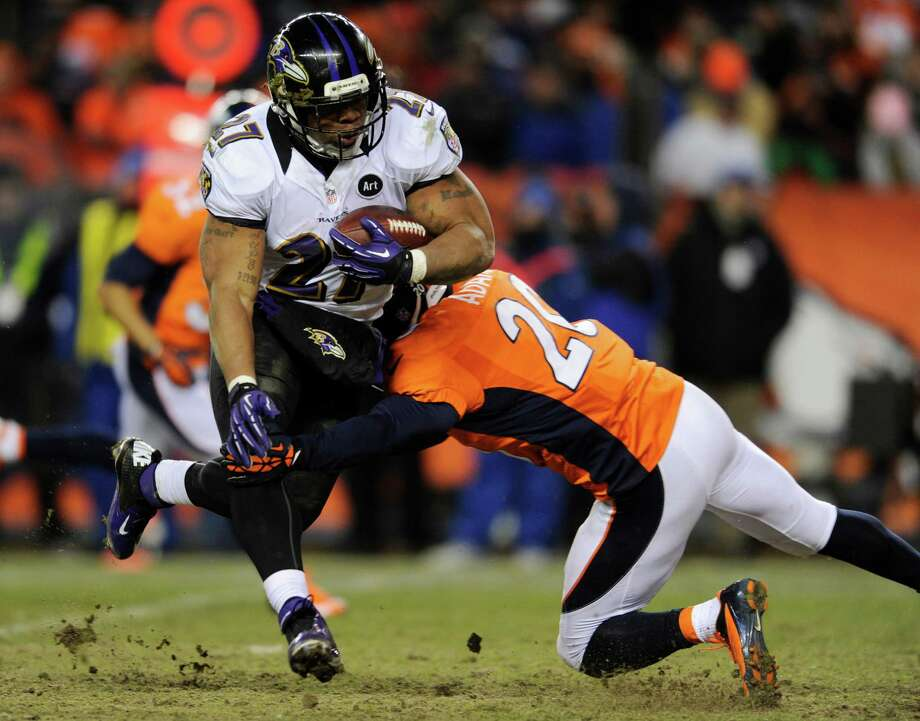 Baltimore Ravens running back Ray Rice (27) is hit by Denver Broncos strong safety Mike Adams (20) in the third quarter of an AFC divisional playoff NFL football game, Saturday, Jan. 12, 2013, in Denver. (AP Photo/Jack Dempsey) Photo: Jack Dempsey, Associated Press / FR42408 AP