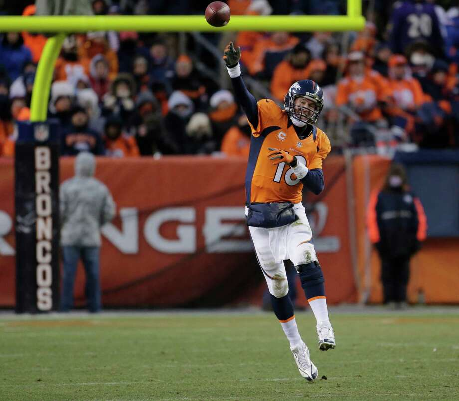Denver Broncos quarterback Peyton Manning passes against the Baltimore Ravens in the third quarter of an AFC divisional playoff NFL football game, Saturday, Jan. 12, 2013, in Denver. (AP Photo/Charlie Riedel) Photo: Charlie Riedel, Associated Press / AP