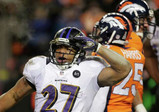 Baltimore Ravens running back Ray Rice salutes after scoring a touchdown against the Denver Broncos in the third quarterof an AFC divisional playoff NFL football game, Saturday, Jan. 12, 2013, in Denver. (AP Photo/Charlie Riedel) Photo: Charlie Riedel, Associated Press / AP