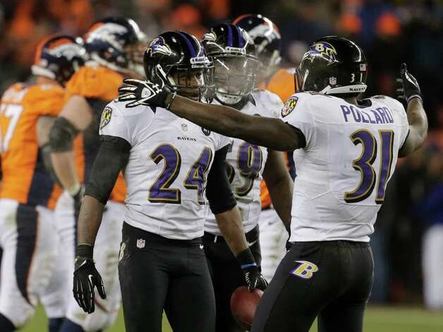 Baltimore Ravens cornerback Corey Graham (24) is congratulated by Baltimore Ravens strong safety Bernard Pollard (31) after intercepting a pass against the Denver Broncos in overtime of an AFC divisional playoff NFL football game, Saturday, Jan. 12, 2013, in Denver. The Ravens won 38-35. (AP Photo/Charlie Riedel) Photo: Charlie Riedel, Associated Press / AP