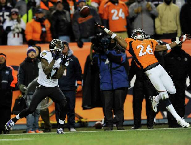 Baltimore Ravens wide receiver Jacoby Jones (12) catches a pass for a touchdown despite the defense of Denver Broncos free safety Rahim Moore (26) late in the fourth quarter of an AFC divisional playoff NFL football game, Saturday, Jan. 12, 2013, in Denver. (AP Photo/Jack Dempsey) Photo: Jack Dempsey, Associated Press / FR42408 AP
