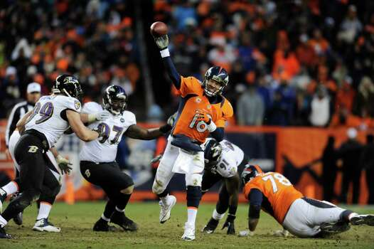 Denver Broncos quarterback Peyton Manning (18) passes against the Baltimore Ravens in the third quarter of an AFC divisional playoff NFL football game, Saturday, Jan. 12, 2013, in Denver. (AP Photo/Jack Dempsey) Photo: Jack Dempsey, Associated Press / FR42408 AP