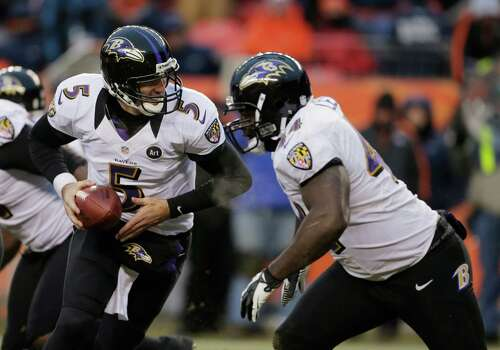 Baltimore Ravens quarterback Joe Flacco (5) looks to hand off the ball against the Denver Broncos in the third quarter of an AFC divisional playoff NFL football game, Saturday, Jan. 12, 2013, in Denver. (AP Photo/Charlie Riedel) Photo: Charlie Riedel, Associated Press / AP