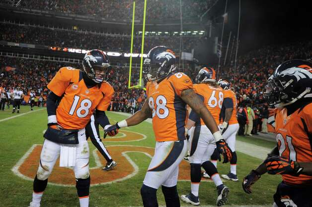 Denver Broncos quarterback Peyton Manning (18) congratulates wide receiver Demaryius Thomas (88) after Thomas scored a touchdown against the Baltimore Ravens in the fourth quarter of an AFC divisional playoff NFL football game, Saturday, Jan. 12, 2013, in Denver. (AP Photo/Jack Dempsey) Photo: Jack Dempsey, Associated Press / FR42408 AP