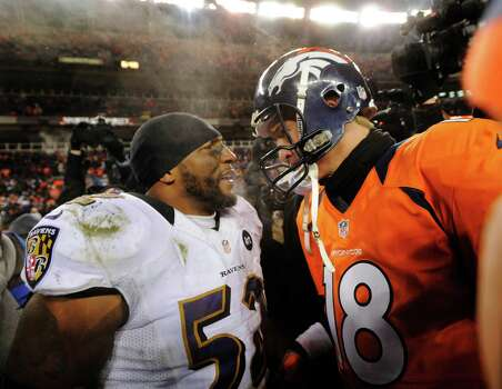 Baltimore Ravens inside linebacker Ray Lewis talks with Denver Broncos quarterback Peyton Manning (18) after the Ravens won 38-35 in overtime of an AFC divisional playoff NFL football game, Saturday, Jan. 12, 2013, in Denver. (AP Photo/Jack Dempsey) Photo: Jack Dempsey, Associated Press / FR42408 AP