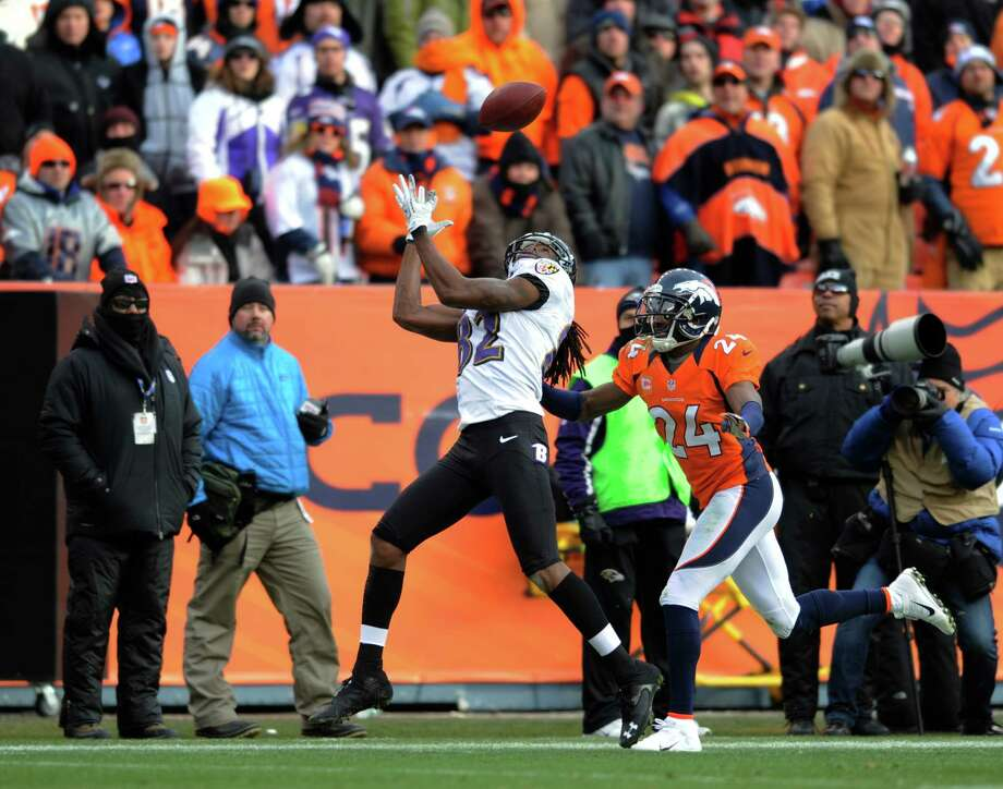 Baltimore Ravens wide receiver Torrey Smith (82) catches a pass against Denver Broncos cornerback Champ Bailey (24) in the second quarter of an AFC divisional playoff NFL football game, Saturday, Jan. 12, 2013, in Denver. (AP Photo/Jack Dempsey) Photo: Jack Dempsey, Associated Press / FR42408 AP