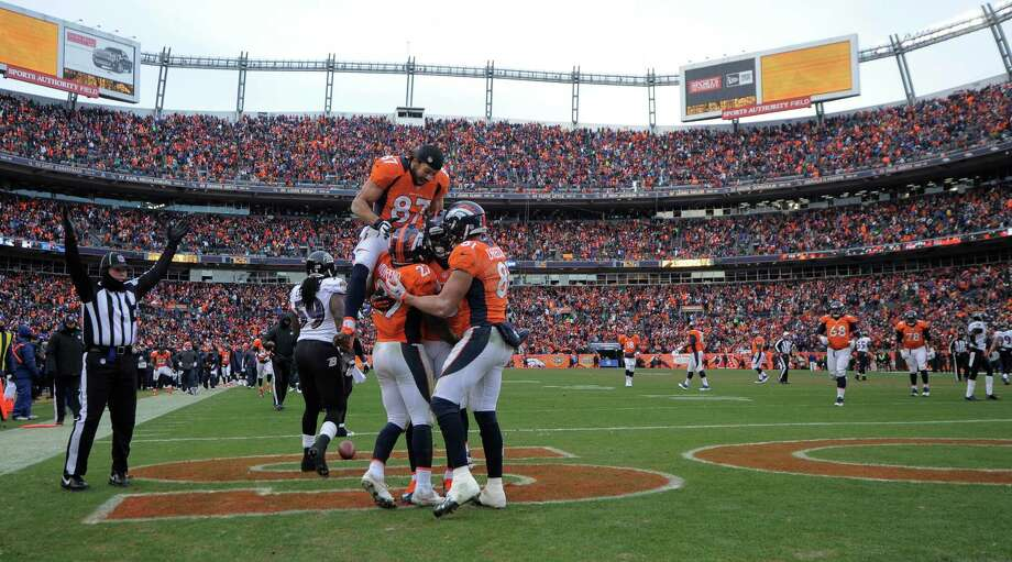 Denver Broncos wide receiver Eric Decker (87) celebrates with teammates after running back Knowshon Moreno (27) caught a touchdown pass against the Baltimore Ravens in the second quarter of an AFC divisional playoff NFL football game, Saturday, Jan. 12, 2013, in Denver. (AP Photo/Jack Dempsey) Photo: Jack Dempsey, Associated Press / FR42408 AP