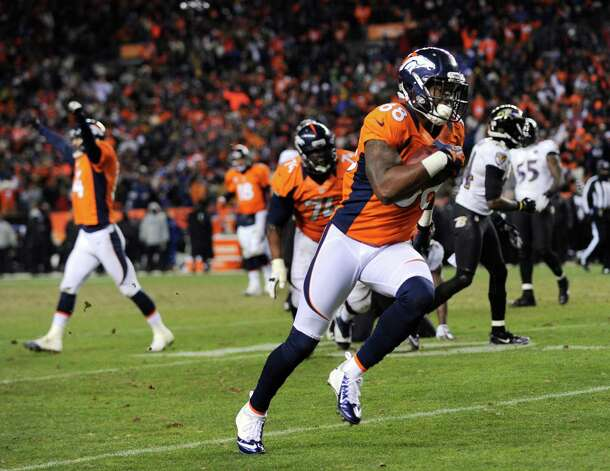 Denver Broncos wide receiver Demaryius Thomas (88) runs the ball in for a touchdown against the Baltimore Ravens in the fourth quarter of an AFC divisional playoff NFL football game, Saturday, Jan. 12, 2013, in Denver. (AP Photo/Jack Dempsey) Photo: Jack Dempsey, Associated Press / FR42408 AP