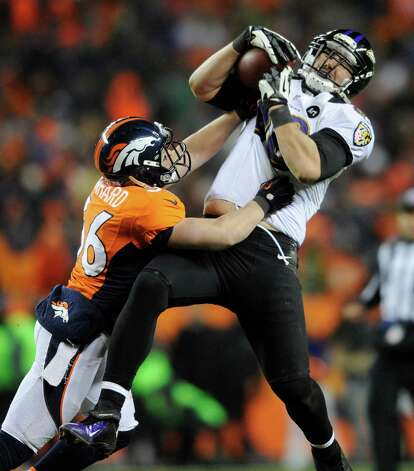 Baltimore Ravens tight end Dennis Pitta (88) comes down with a pass against Denver Broncos free safety Jim Leonhard (36) in overtime of an AFC divisional playoff NFL football game, Saturday, Jan. 12, 2013, in Denver. (AP Photo/Jack Dempsey) Photo: Jack Dempsey, Associated Press / FR42408 AP