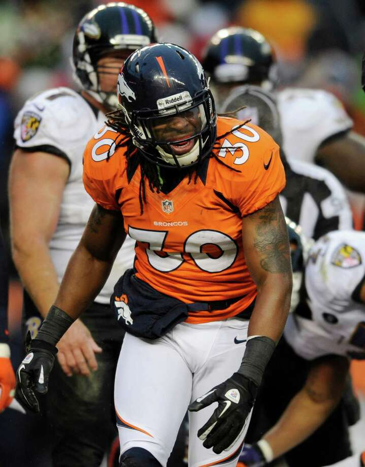 Denver Broncos free safety David Bruton (30) shouts after sacking Baltimore Ravens quarterback Joe Flacco in the third quarter of an AFC divisional playoff NFL football game, Saturday, Jan. 12, 2013, in Denver. (AP Photo/Jack Dempsey) Photo: Jack Dempsey, Associated Press / FR42408 AP