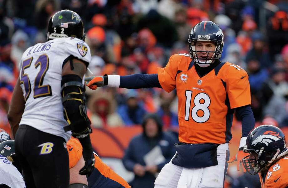 Baltimore Ravens inside linebacker Ray Lewis, left, watches as Denver Broncos quarterback Peyton Manning calls a play at the line of scrimmage against the Baltimore Ravens in the second quarter of an AFC divisional playoff NFL football game, Saturday, Jan. 12, 2013, in Denver. (AP Photo/Charlie Riedel) Photo: Charlie Riedel, Associated Press / AP