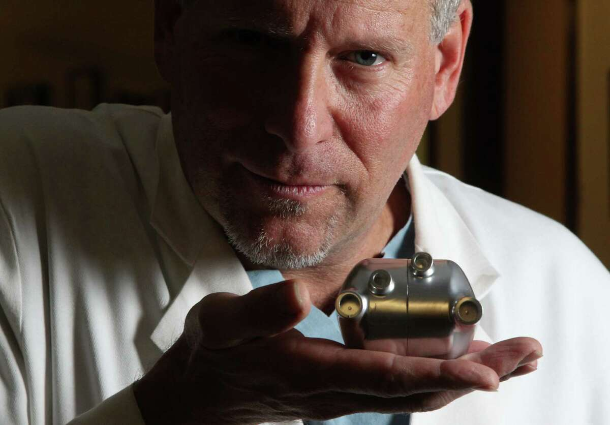 The revolutionary BiVACOR device fits in the palm of Dr. Billy Cohn's hand at Houston's Texas Heart Institute.