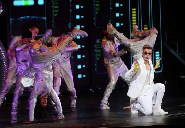 "Justin Bieber and dancers perform at the AT&T Center on a stop of the ""Believe"" tour on Saturday night, Jan. 12, 2013. Photo: Billy Calzada, San Antonio Express-News / SAN ANTONIO EXPRESS-NEWS"