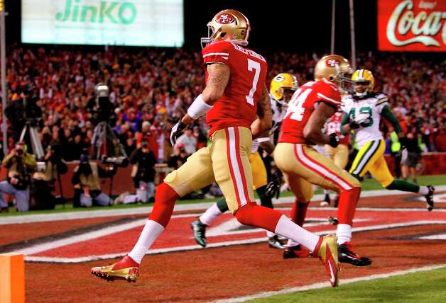 Quarterback Colin Kaepernick (7) runs in a  touchdown in the first quarter of  the San Francisco 49ers game against the Green Bay Packers in the NFC Divisional Playoffs at Candlestick Park in San Francisco, Calif., on Saturday January 12, 2013. Photo: Micheal Macor, The Chronicle / ONLINE_YES