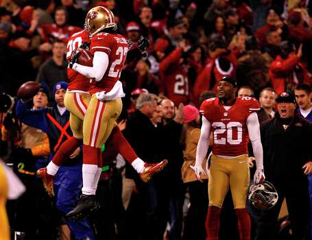 Safety C.J. Spillman (27) celebrates with Running back Rock Cartwright (28) after a recovered fumble in the second quarter of the San Francisco 49ers game against the Green Bay Packers in the NFC Divisional Playoffs at Candlestick Park in San Francisco, Calif., on Saturday January 12, 2013. Photo: Carlos Avila Gonzalez, The Chronicle / ONLINE_YES