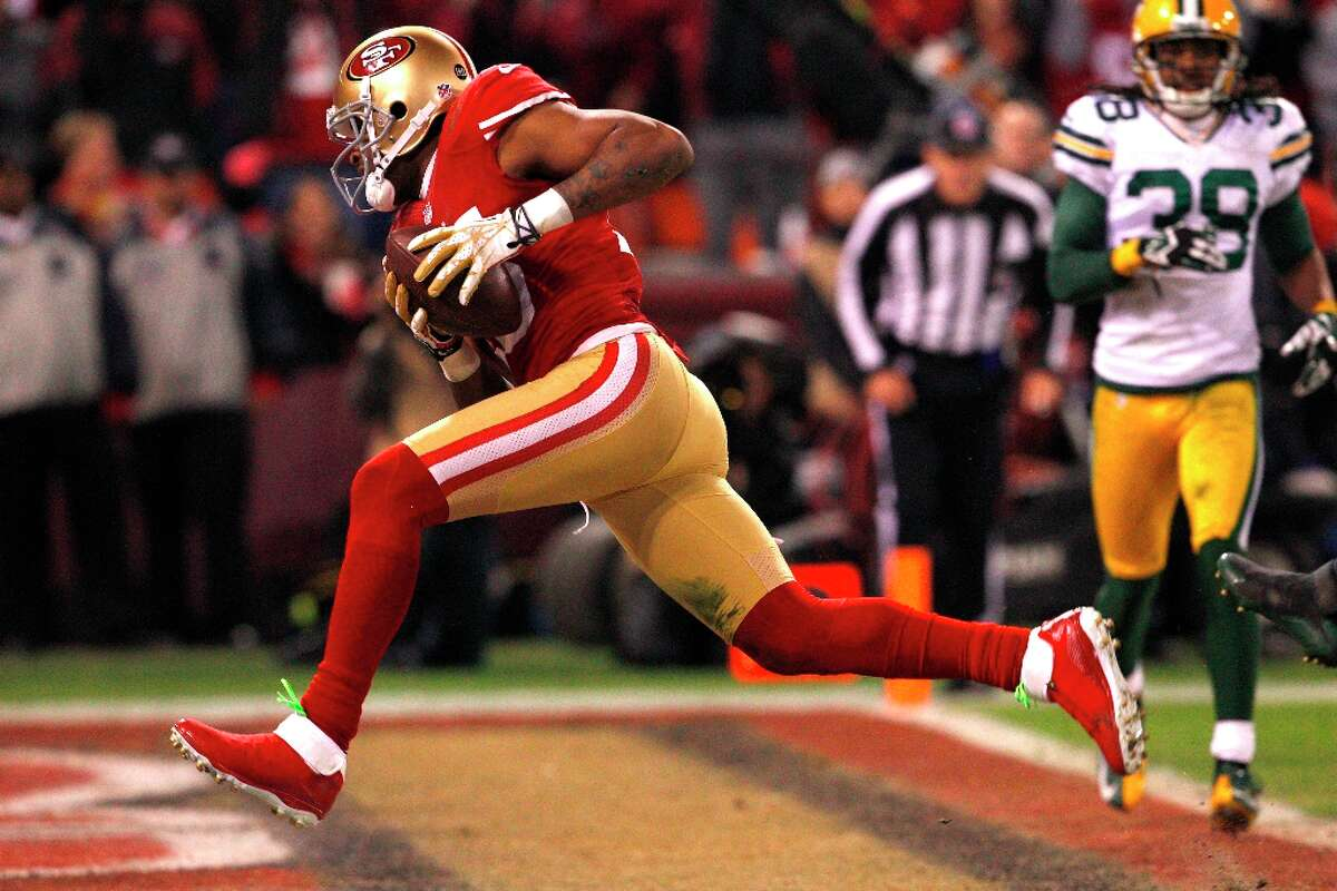 Wide receiver Michael Crabtree (15) scores a touchdown after a recovered fumble in the second half of the San Francisco 49ers game against the Green Bay Packers in the NFC Divisional Playoffs at Candlestick Park in San Francisco, Calif., on Saturday January 12, 2013.