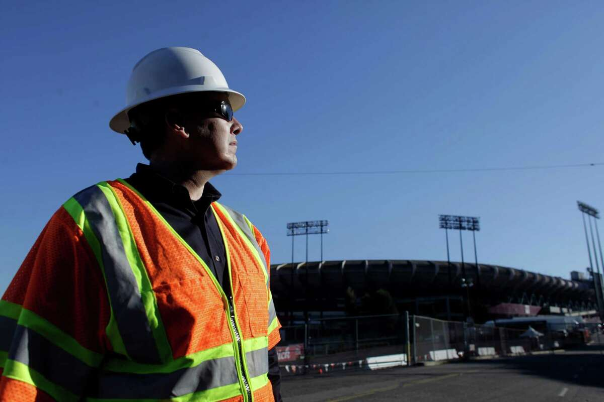 Jason Regan, a maintenance and construction electrical supervisor for PG&E looks over the above ground lines that shorted out during a Monday Night Football game at Candlestick Park, Thursday January 12, 2012, in San Francisco, Calif. They have been repaired and upgraded to ensure nothing will happen during Saturdays playoff game.