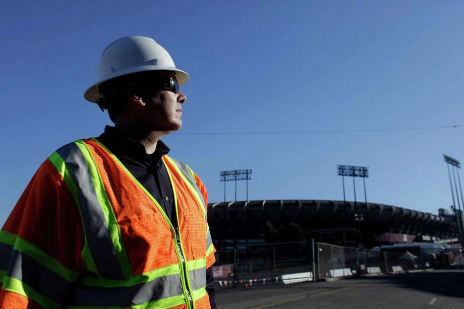 Jason Regan, a maintenance and construction electrical supervisor for PG&E looks over the above ground lines that shorted out during a Monday Night Football game at Candlestick Park, Thursday January 12, 2012, in San Francisco, Calif. They have been repaired and upgraded to ensure nothing will happen during Saturdays playoff game. Photo: Lacy Atkins, Staff / ONLINE_YES